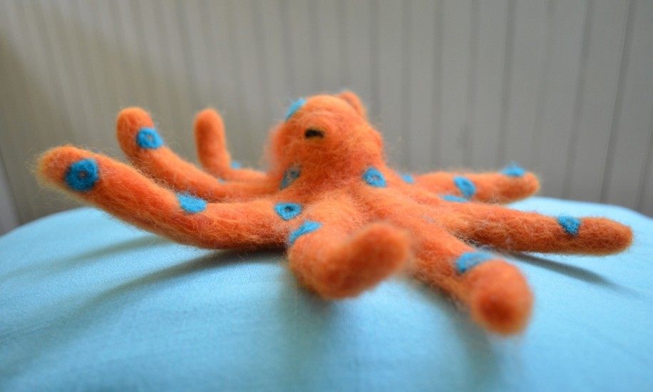 My husband's favorite animal is the octopus, and his favorite color is orange, so I needle felted a little octopus friend for him!