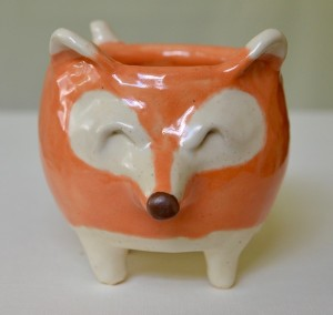 This adorable fox mug will hold 8 ounces of your beverage of choice. His tail doubles as a handle, so you can get your caffeine fix comfortably and in style! He simply can't wait to join your coffee mug collection!