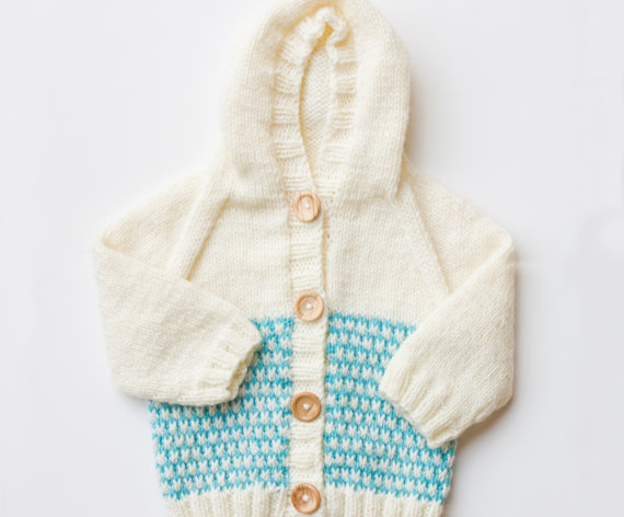 This adorable baby hoodie is one of our favorite newborn knitting patterns!