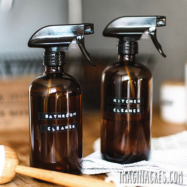 two brown spray bottles with homemade cleaners