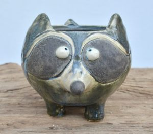 Rocky the raccoon mug is just itching to come home with you. He promises he won't dig through your trash if you treat him well! Rocky is dishwasher safe and will hold 12 ounces of your favorite beverage