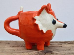 Sylvester is a wily little fox. He needs someone to look out for him and keep him out of trouble! Sylvester is dishwasher safe and holds 12 ounces of your favorite beverage!