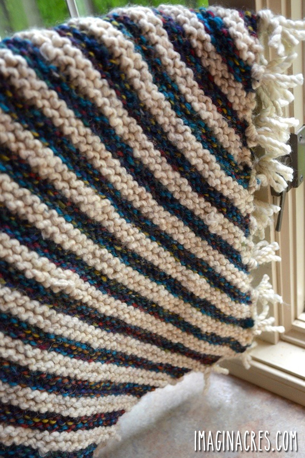 striped baby blanket with fringed edge