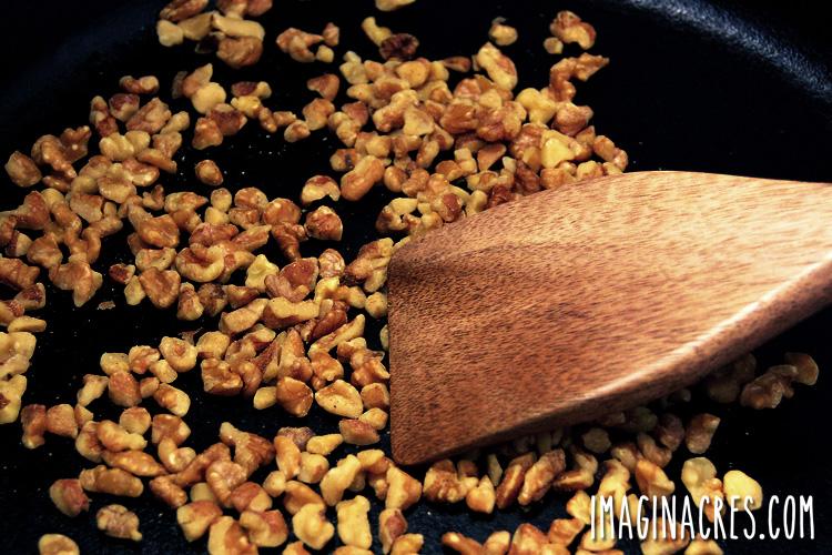 closeup of black walnuts in a skillet