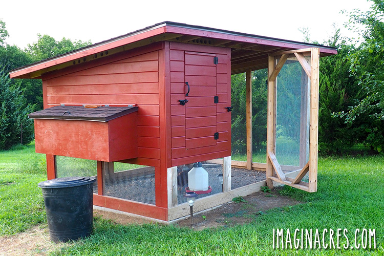 red chicken coop with pen