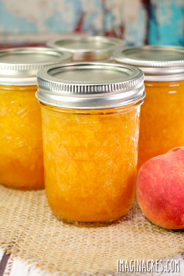 closeup of peach jam in canning jars